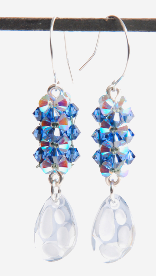 Cubic Right Angle Weave beaded beads used in a pair of earrings that also feature the new Swarovski crystal radiolarian pendant.