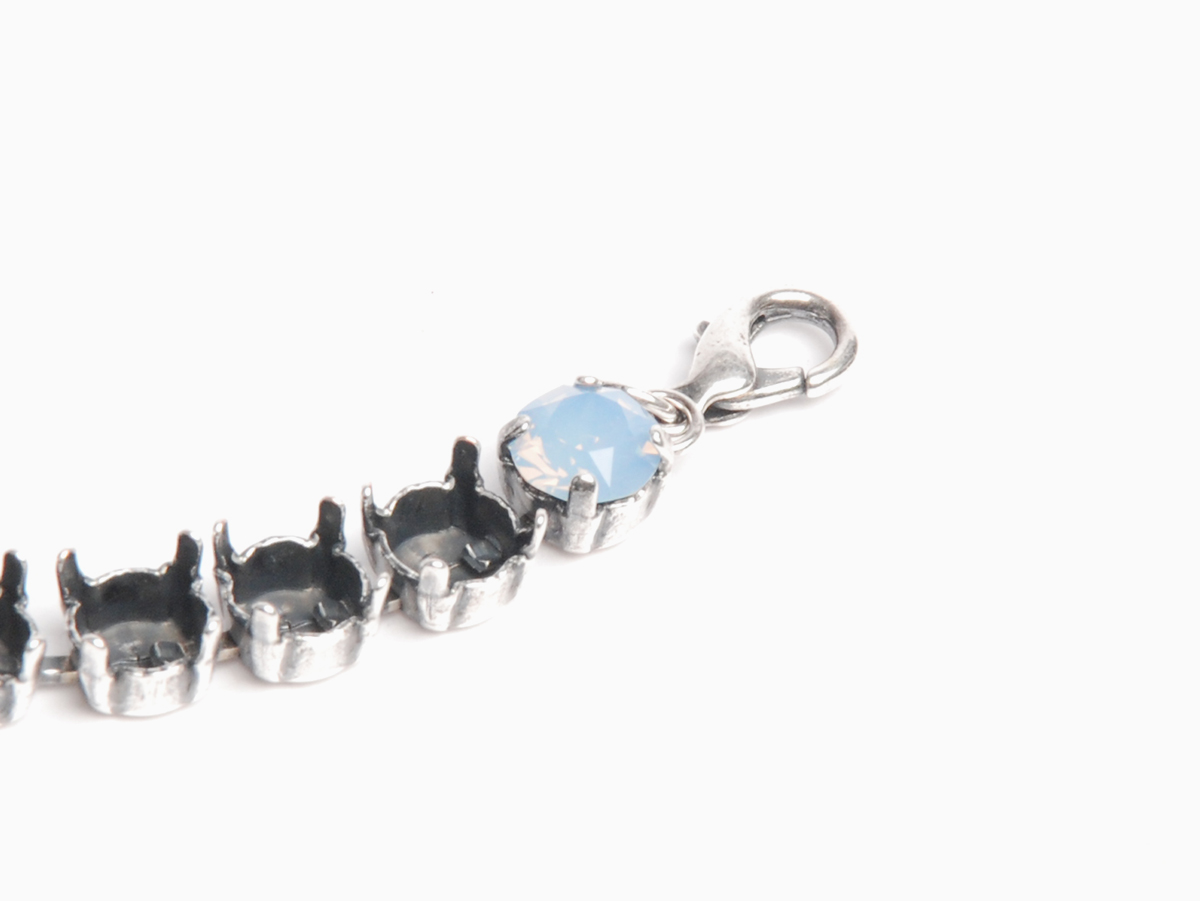 all four prongs set, securing the chaton in place. Silver oxide cup chain bracelet; air blue opal Swarovski crystal chaton