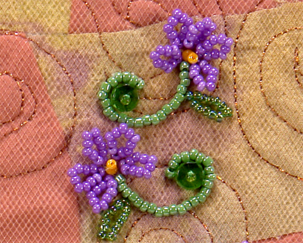 flower petals, curved beaded stems, and beaded stop stitch