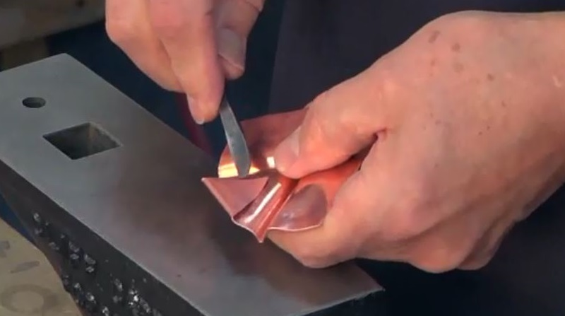 opening a fold in fold-formed metal