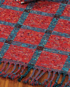 The Peekaboo Rep Rug designed by Karla Stille is a weaving rug pattern and can be found in our free Weaving with Rags eBook