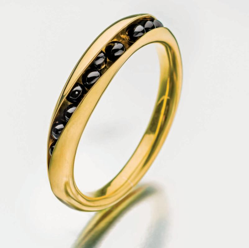 bracelets: Bill Fretz 3D brass bangle with onyx beads