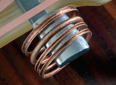 Copper prototypes for Bill's stacking silver bangles. Photo: Bill Fretz