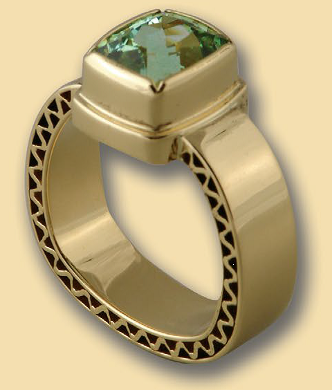 Bill was first inspired to design his own jewelry tools after the famous tourmaline strike in Newry, Maine, in the 1970s. Shown: Bill Fretz's 18K gold corrugated ring with Newry, Maine, tourmaline, fabricated and cast; photo courtesy Bill Fretz