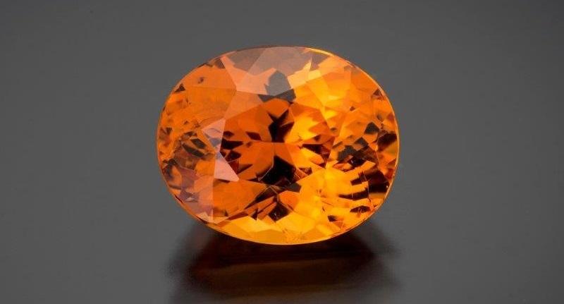 gemstones: oval spessartite garnet