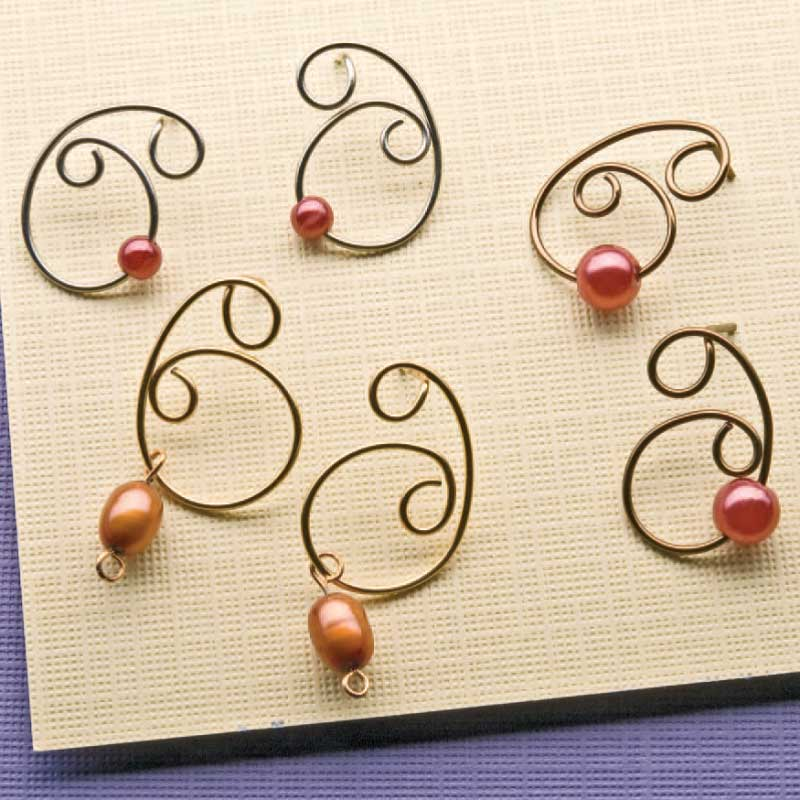 Simple pearl earrings by Cindy Gimbrone made with a simple cut, twist and form of some wire.