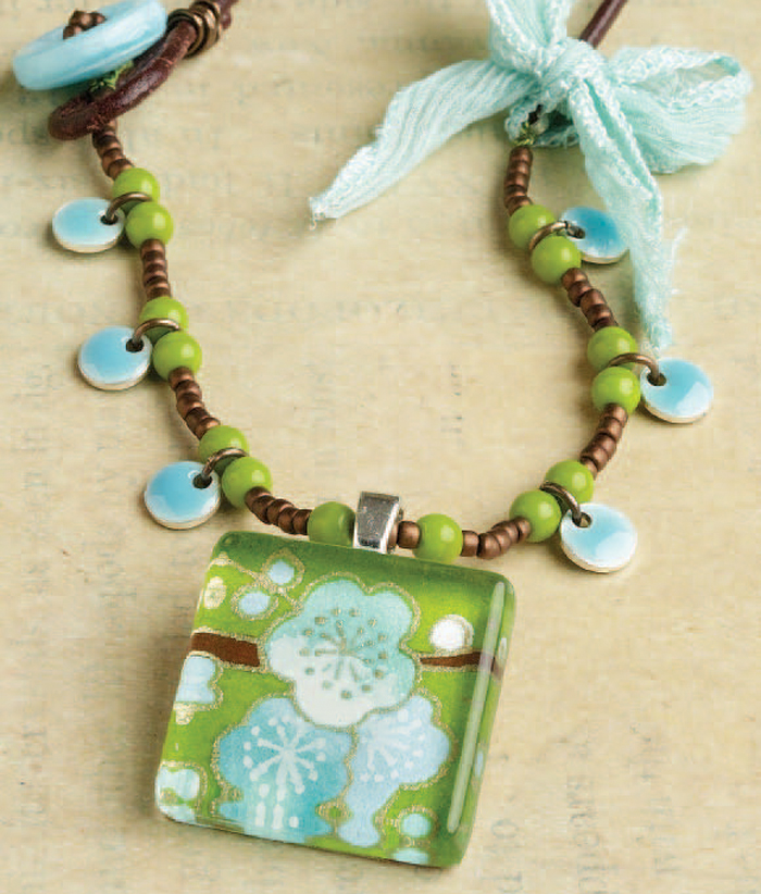 Learn how to make this mixed-media necklace with a glass tile in our free mixed-media jewelry eBook.