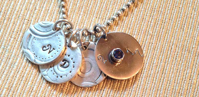 Metalsmithing: Quick & Easy Jewelry Gifts Celebrating Milestones. Assembled charms to celebrate children.