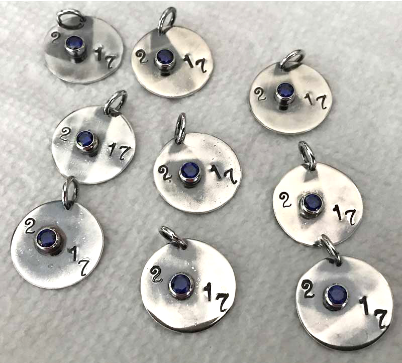 Metalsmithing: Quick & Easy Jewelry Gifts Celebrating Milestones. Collection of charms made to celebrate graduation.