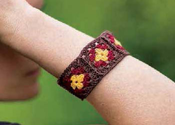 Learn how to crochet this bangle bracelet using granny squares in our free eBook on how to make a granny square and patterns.