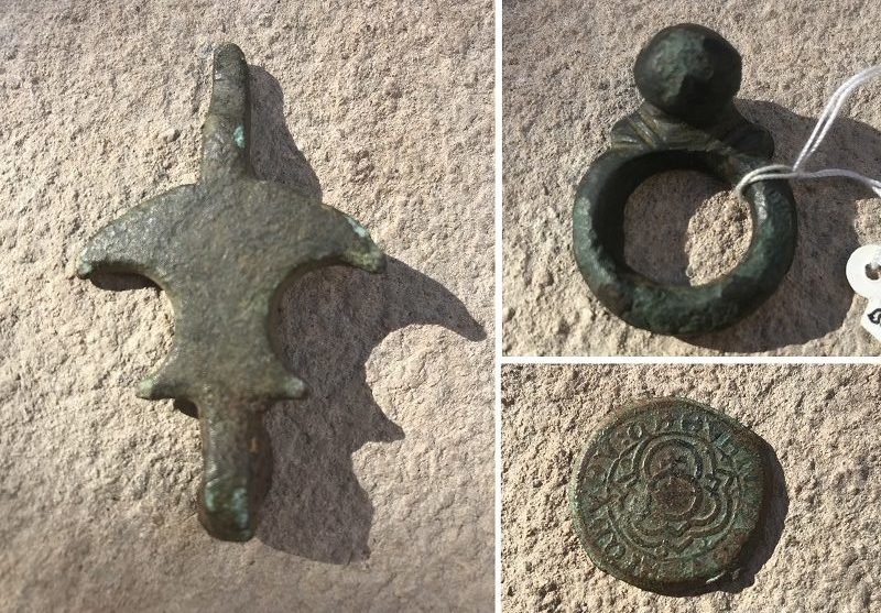 hinge, coin,and horse tack artifacts with natural green patina on copper and brass