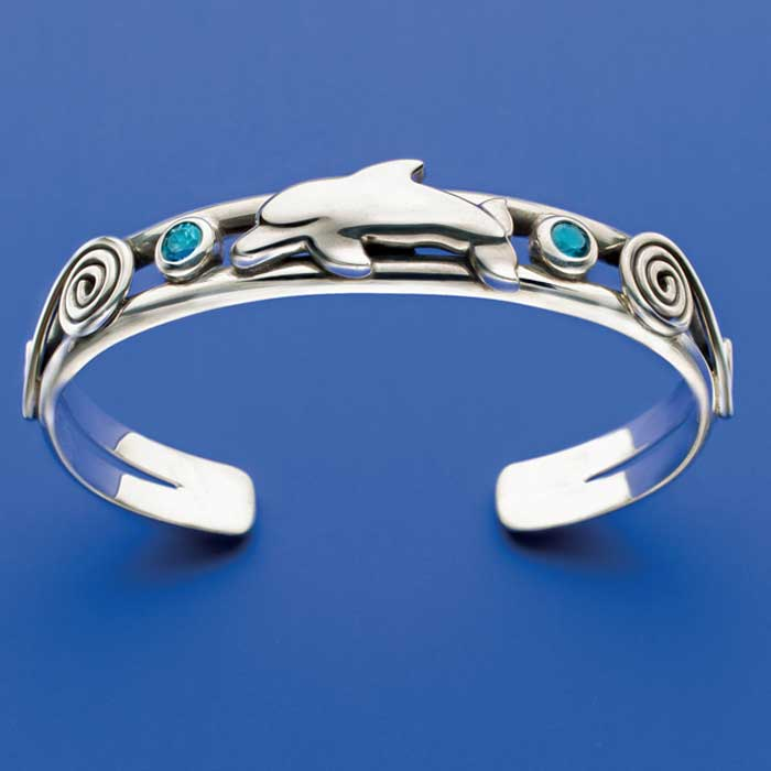 Dolphin and blue zircon stones set off this beautiful cuff bracelet by Roger Halas