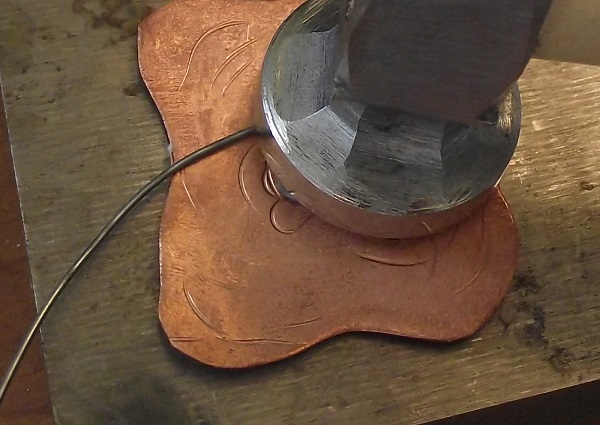 stamp steel wire designs onto copper