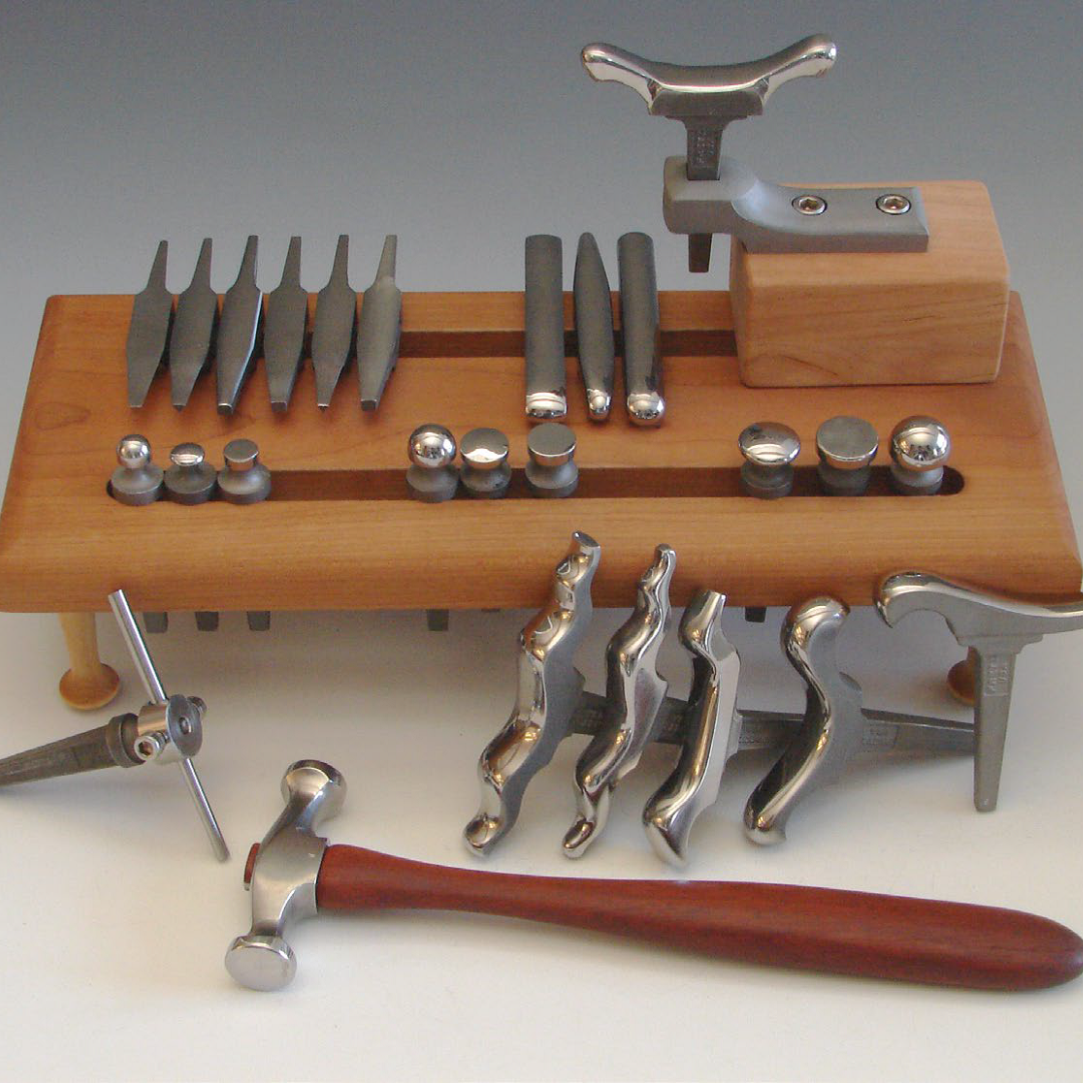 A sample of Bill Fretz's tool collection, with bezel, raising, forming, and mushroom stakes with mandrel holder and universal holder. All of Bill's jewelry tools are hardened stainless steel; photo courtesy Bill Fretz