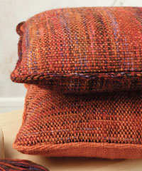 Learn how to use a rigid heddle loom with this free handwoven pillow project.