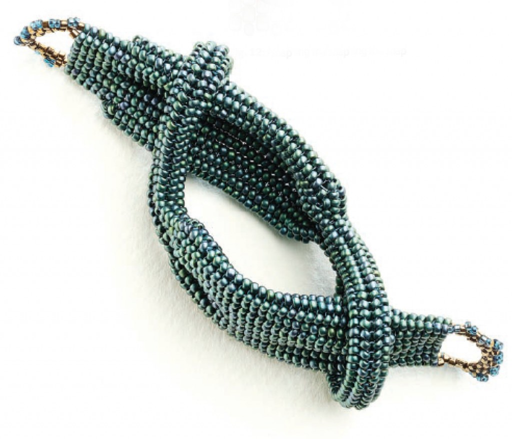 "Tubular herringbone sections are connected together forming the ""Hercules"" knot in this bracelet design by Carole Horn."