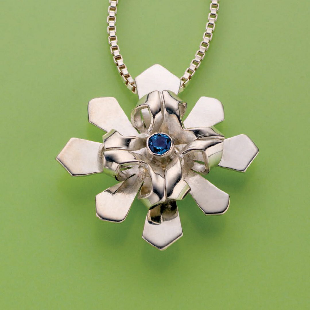 Debra Hoffmaster's Silver Dimensional Pendant was originally published in Lapidary Journal Jewelry Artist, November 2013; photo: Jim Lawson