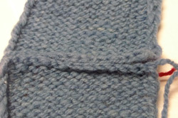 View of the back of the mattress stitch knitting should look like.