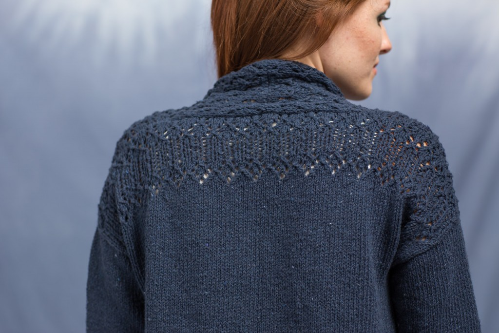 Amy Christoffers' Anil Cardigan has an eye-catching knit lace pattern running across the shoulders.