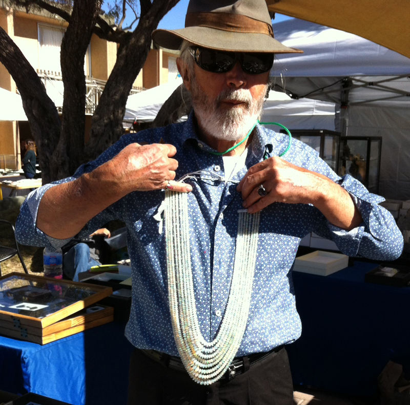 Jay of Jay Rock modeling Crystal Opal Beads. Tucson Gem Show, January 2017. Photo by Merle White.