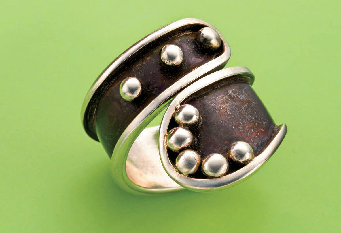 Jeff Fulkerson's Wrap-Around Raindrop Ring, in the April 2016 Lapidary Journal Jewelry Artist, uses patina to highlight the ring's contours and playful drops. The open ends give it an adjustable fit. Photo: Jim Lawson