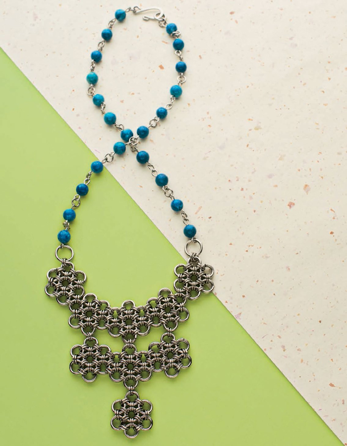 This Victorian floral necklace made from jump rings uses a traditional Japanese chainmaille technique. Don't miss this FREE chain maille necklace project found in our FREE chain maille beaded jewelry eBook.
