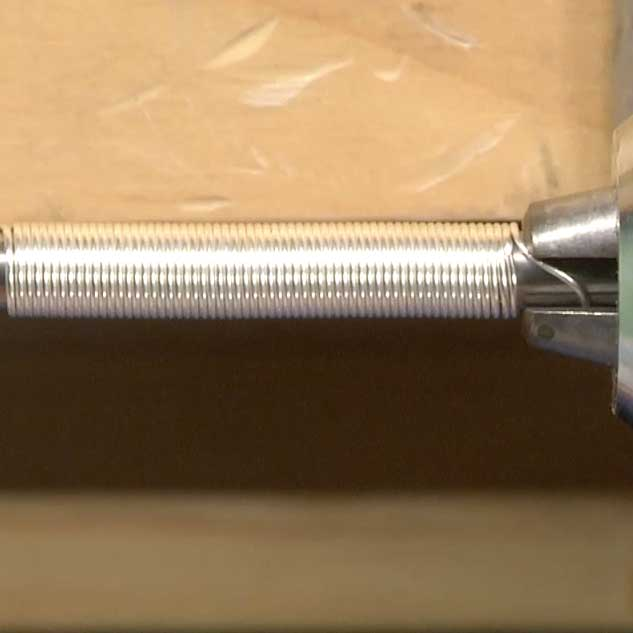 Form a coil of wire on a mandrel to create a consistent-sized coil.