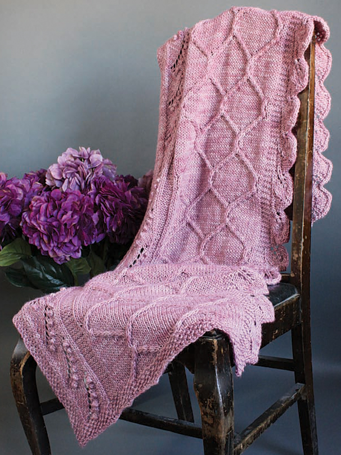 You'll love knitting this free knitted lace pattern called the Espalier Wrap.