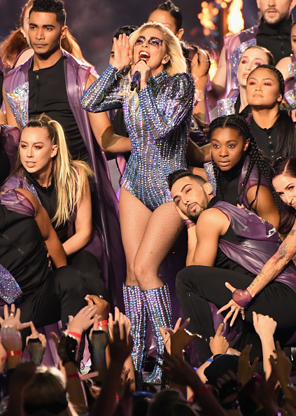 Musician Lady Gaga performs onstage at the Super Bowl LI Halftime Show with a bead and embroidered ensemble.