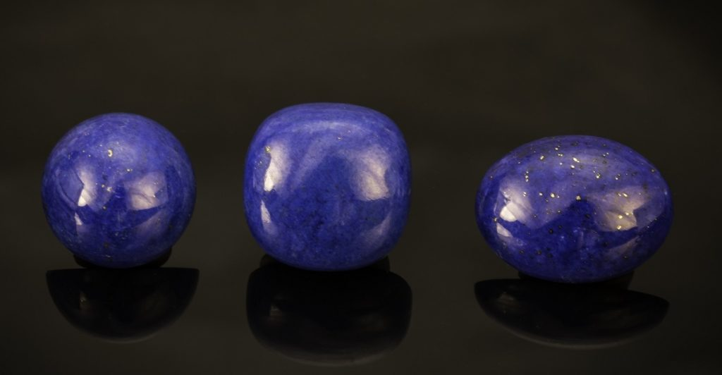 Dark blue gems like these lapis lazuli cabs, worn in cufflinks or as earrings, would reinforce the impression of authority and trust announced by a dark blue business suit. Photo Mia Dixon, courtesy Pala International.