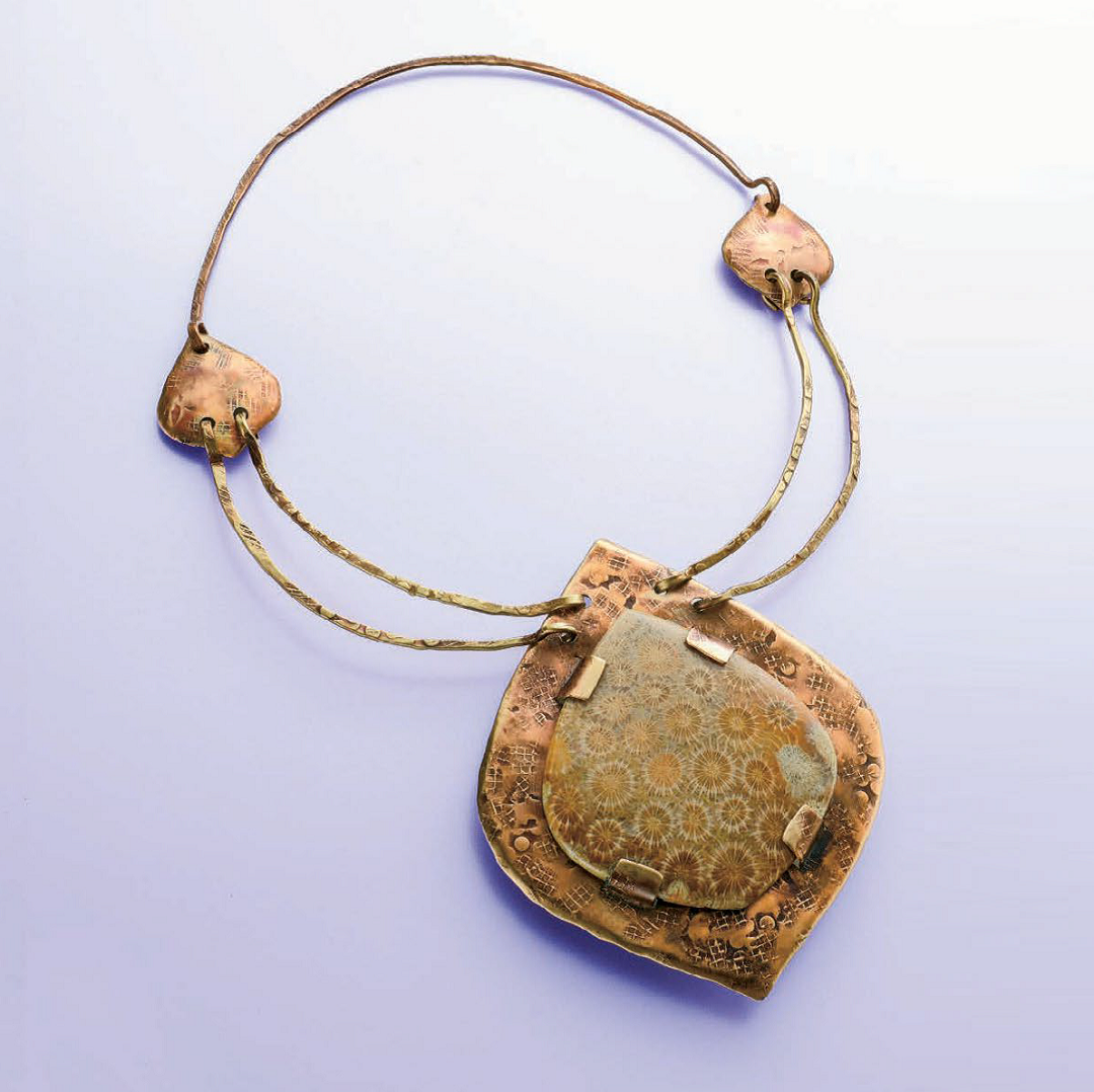 Linda Larsen's Tabbed Fossil Coral Pendant, in a richly textured earthy palette, was originally published in Lapidary Journal Jewelry Artist, January/February 2012; photo: Jim Lawson