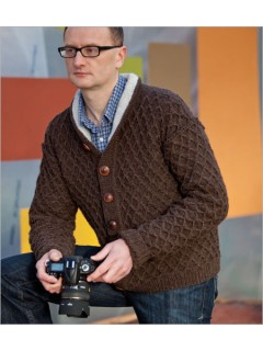 A men's cardigan is made reversible by a doubled foldover collar, deliberately exposed seams, buttons on both sides of buttonband, and an intriguing stitch pattern that looks good on both sides.