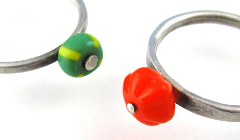 riveted rings with lampwork glass beads by Laurel Nathanson