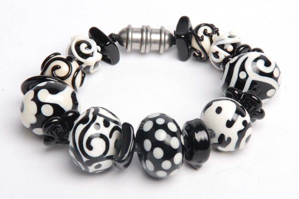 """For the Love of Black & White,"" by Tammy Honaman, 2016, waxed linen, pewter, silver-plated clasp, lampworked glass beads"