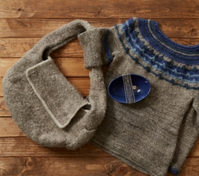 Maggie's wool has so far produced a handy bag with multiple pockets and a sweater.