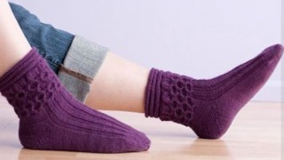 Knit the Honeycomb Socks pattern found in our free eBook on ideas for knitting gifts.