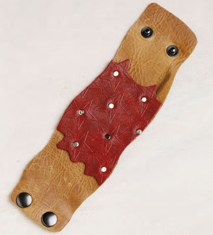 Learn how to make leather bracelets, such as this full-leather cuff, in our FREE eBook.
