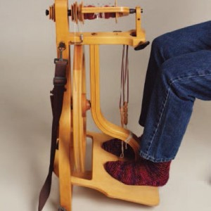 Learn how to spin on a spinning wheel in this making yarn tutorial.