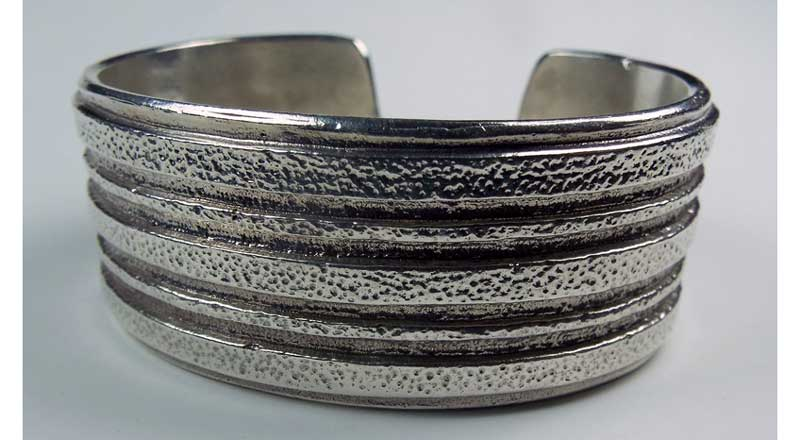 Tufa-cast silver cuff bracelet by Dallas Vuyaoma