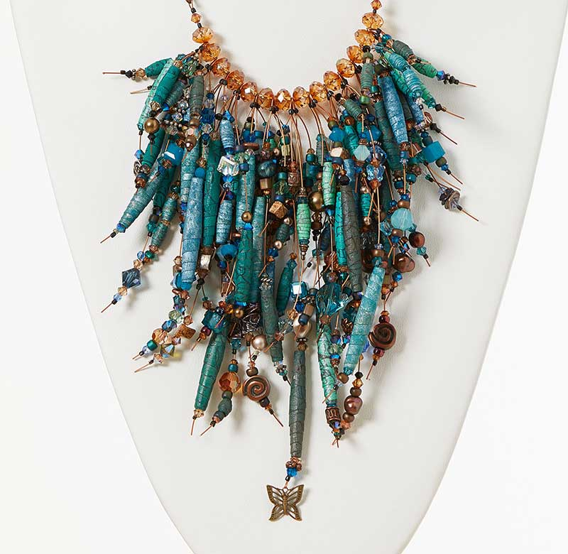 Fabric beads and Swarovski crystal are combined into this amazing necklace design by Kristal Wick. She shares how to make the fabric beads in her latest ecourse.