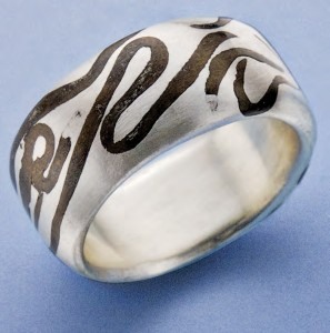 The Married Metal Clay Ring is a silver clay jewelry piece that features a bronze clay contrast.