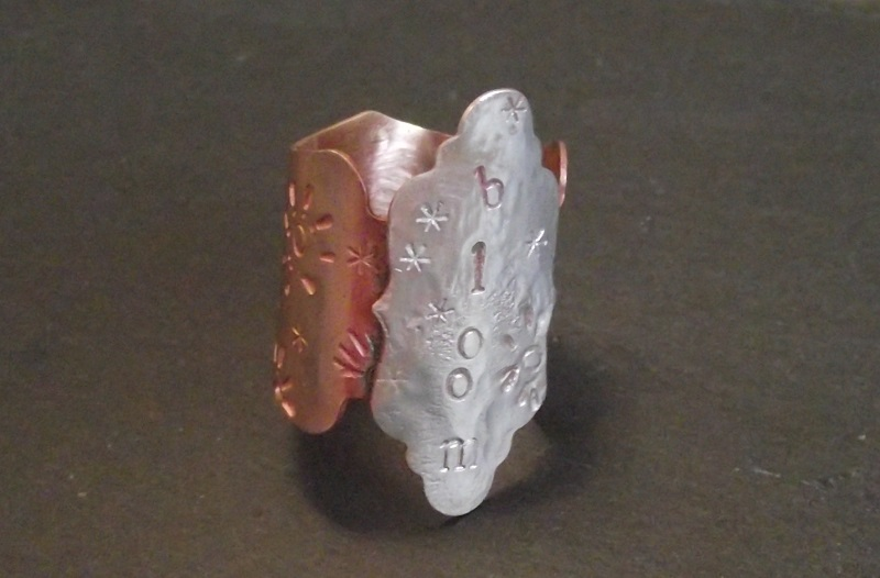 metal stamped punched metal cigar-band style ring