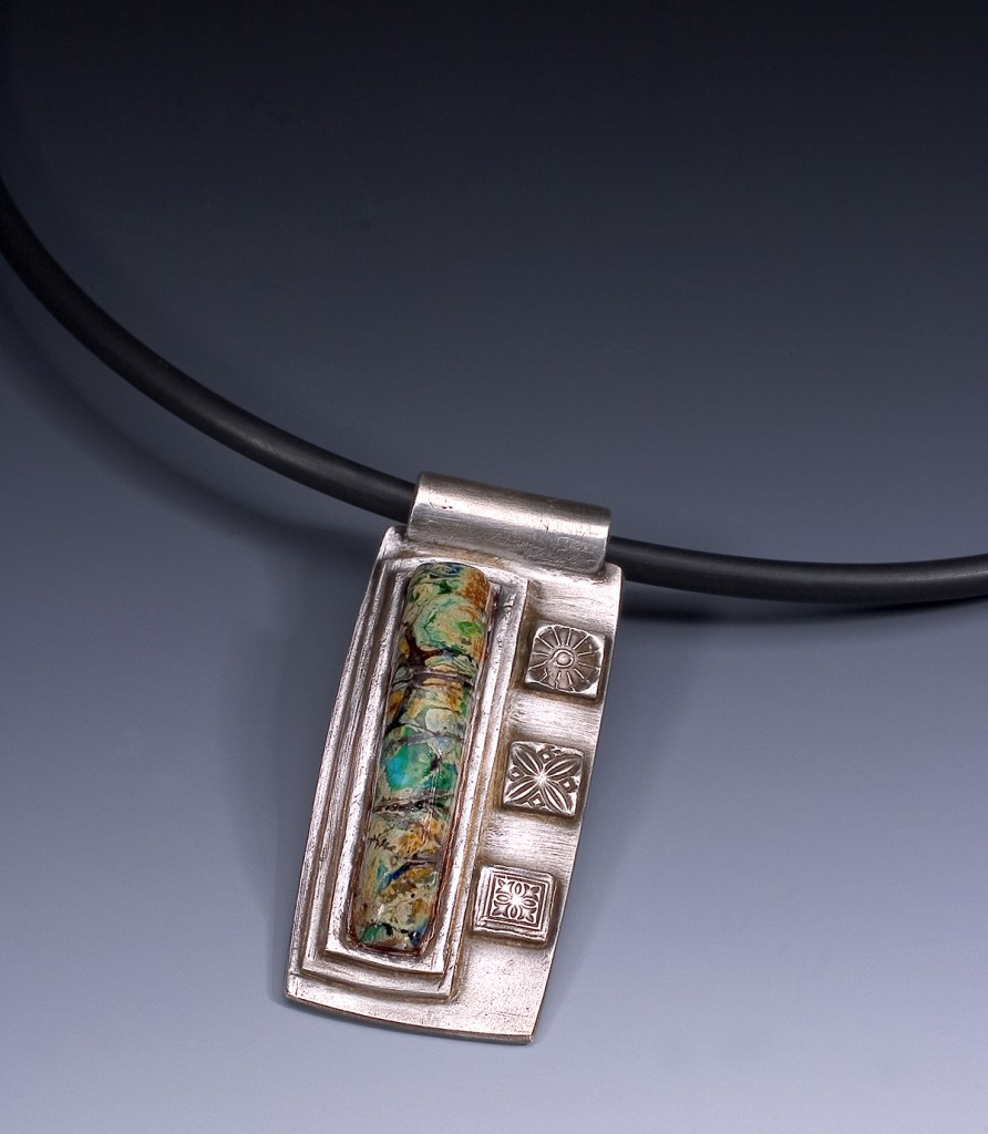 metal clay, glass bead, rubber cord - design by Tammy Honaman, glass bead by John Winter