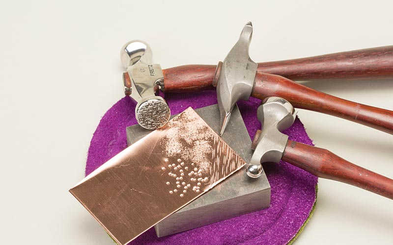 learn essential metalsmithing skills like texturing with hammers from Tracy Stanley, jewelry designer