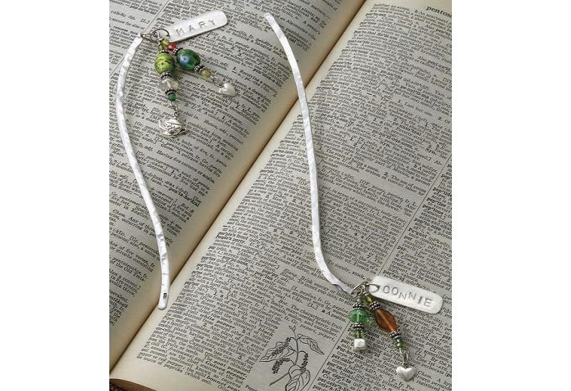 metal stamped jewelry for books by Kathy Grzedzinski