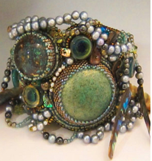 Mixed media cuff by Sherry Serafini, from her website: http://www.serafinibeadedjewelry.com/category_s/1846.htm