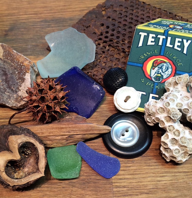 mixed-media grouping including sea glass, coral and buttons