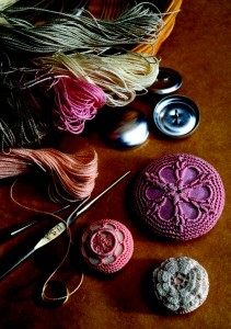 Learn how to crochet these gorgeous vintage-inspired buttons! Great idea for adding elegance to your sewing.