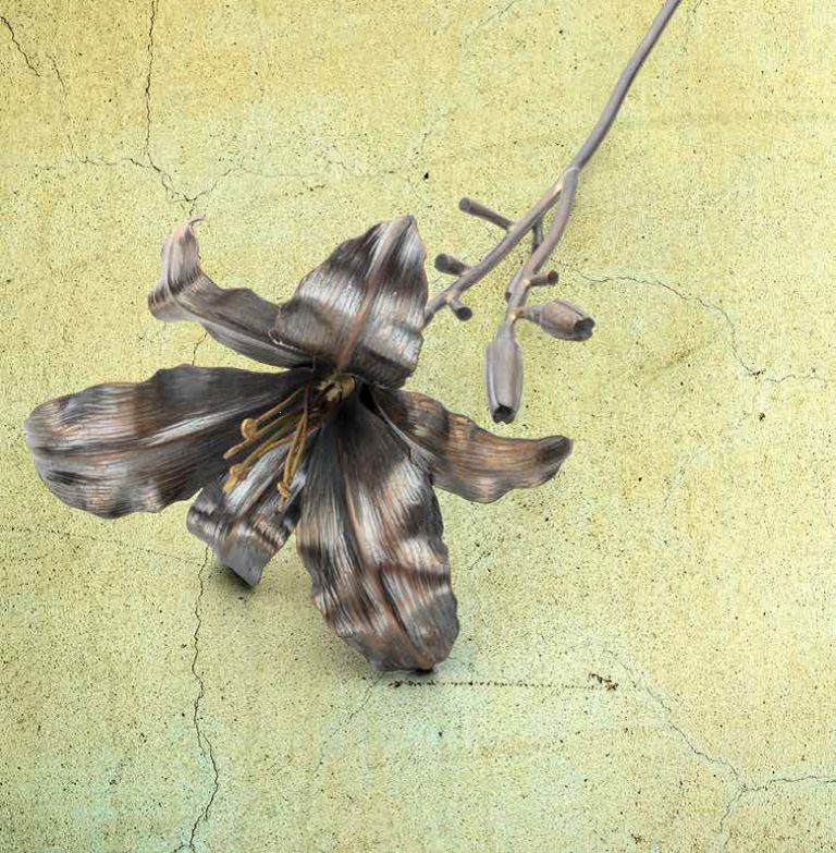 """jewelry designs: """"Steelworks,"""" a profile of Brad Nichols, and his """"Daylily"""" project appeared appeared in the March/April 2018 Lapidary Journal Jewelry Artist; Daylily photo: Jim Lawson."""