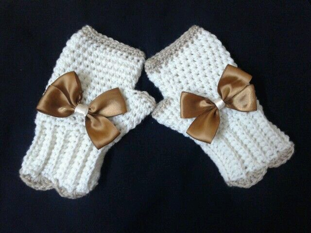These crochet mitts are adorable with their bows.